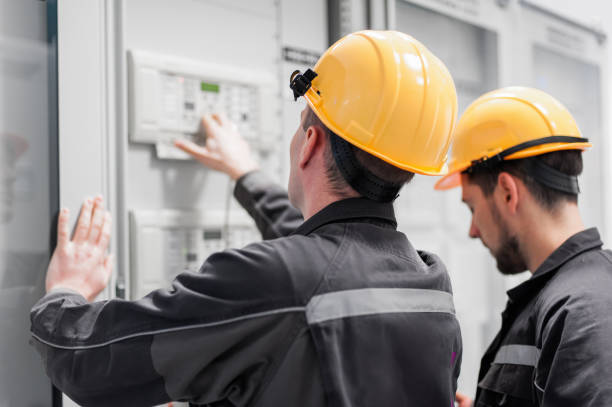 Field service crew testing electronics or inspecting electrical installation system Field service crew testing electronics or inspecting electrical installation system. Bay control unit. Medium voltage switchgear former yugoslavia stock pictures, royalty-free photos & images