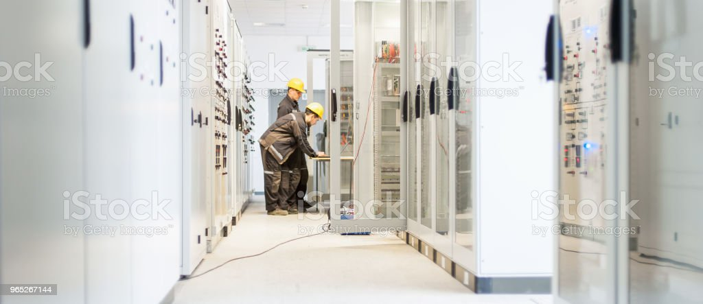 Field service crew testing electronics or inspecting electrical installation system royalty-free stock photo