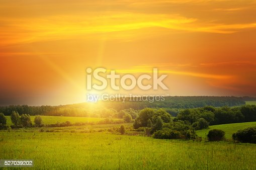 istock field, sunrise and blue sky 527039202