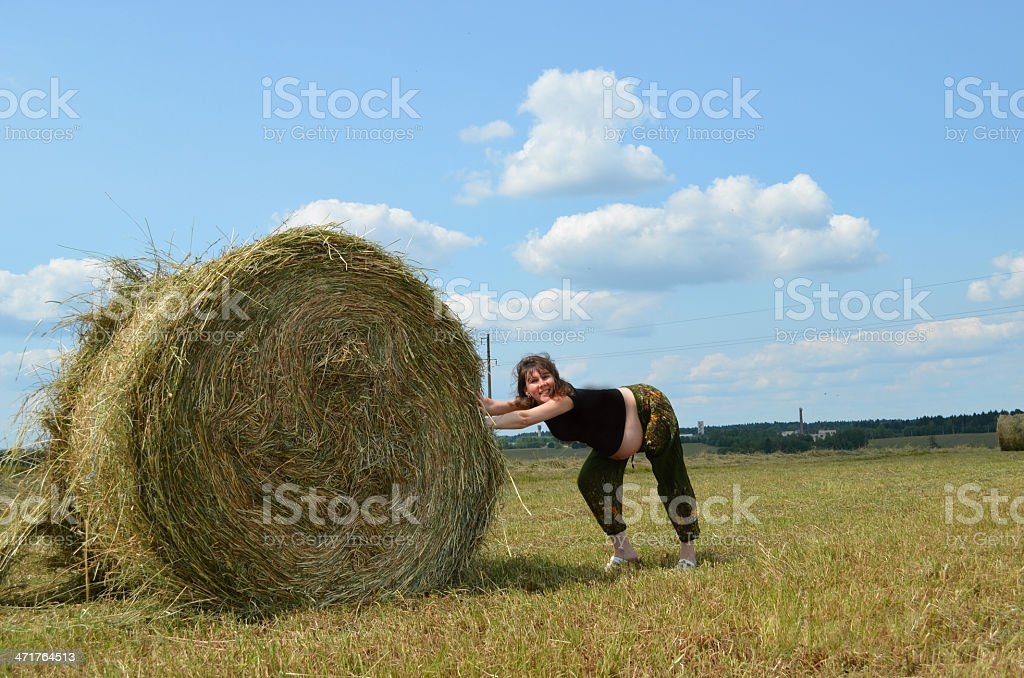Field with hay and woman royalty-free stock photo