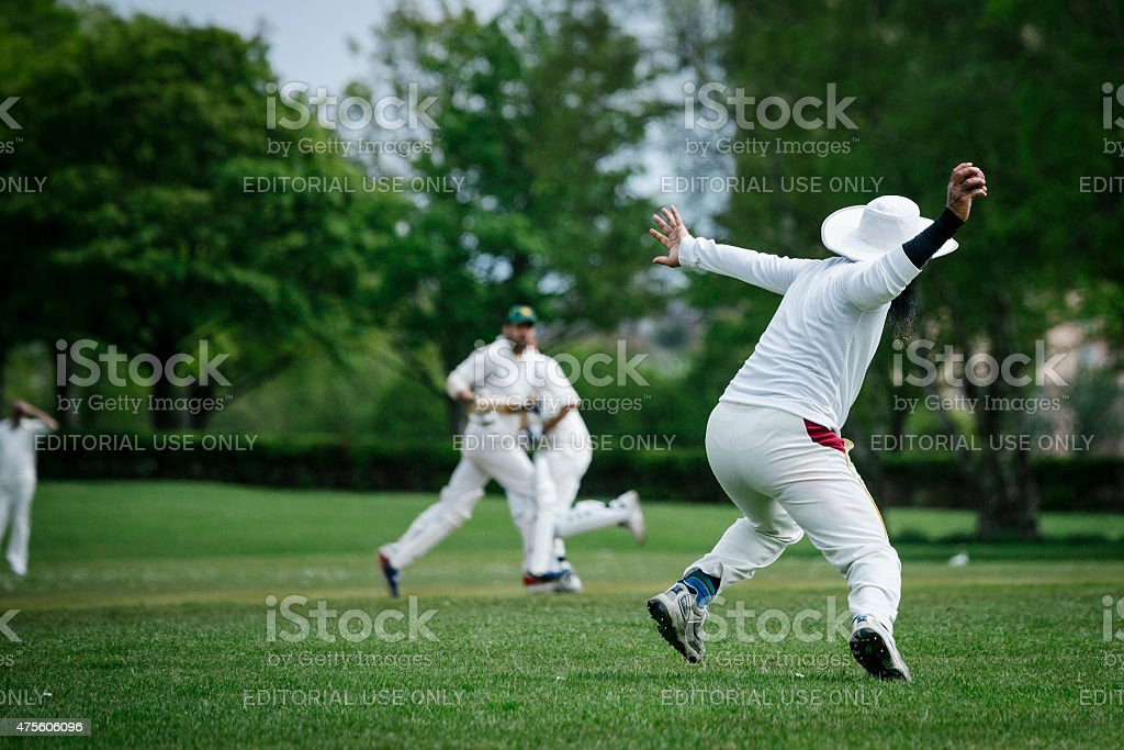 Fielder Throws the Ball in a Local Club Cricket Match stock photo