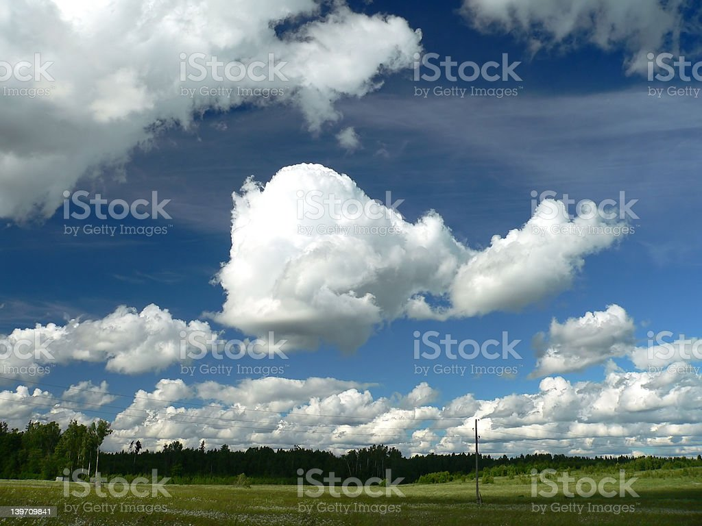 Fields and Sky with Clouds royalty-free stock photo