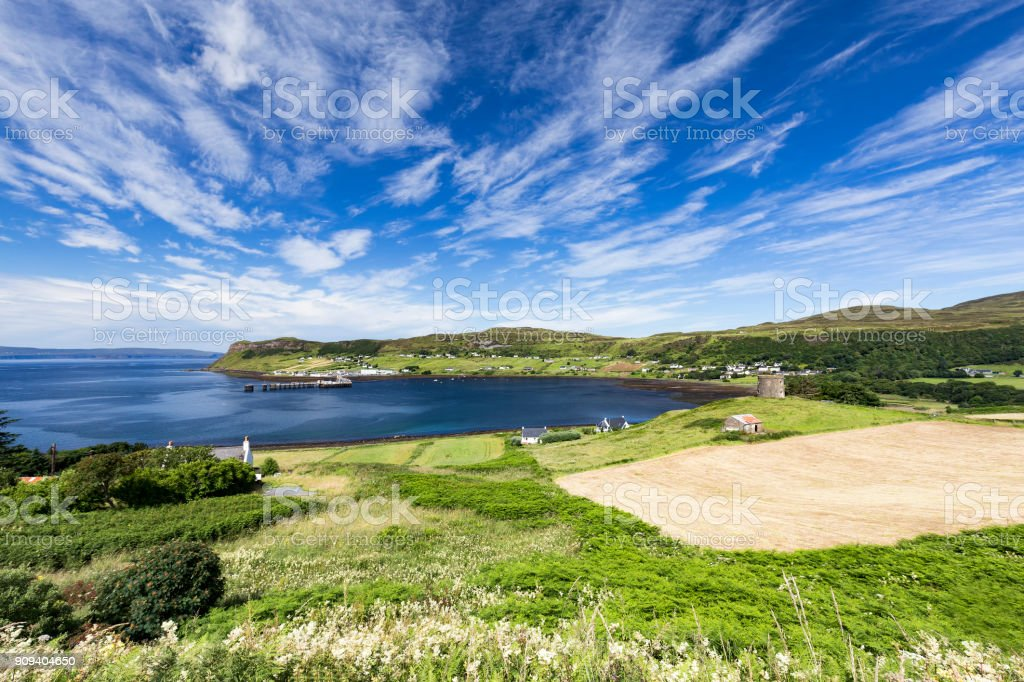 Fields and the town of Uig, Scotland stock photo