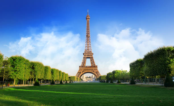 champs de mars - eiffel tower stock photos and pictures