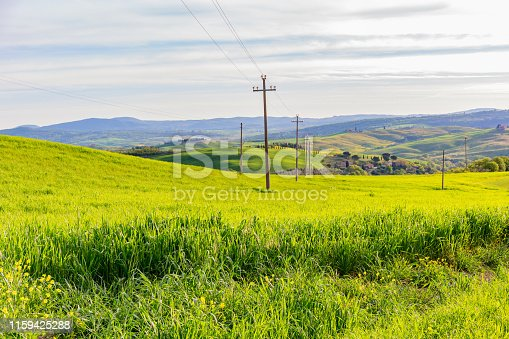 Fields with a power line in a rural landscape