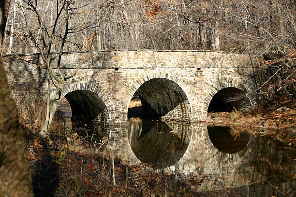 Fieldstone Bridge Over Winter Stream stock photo