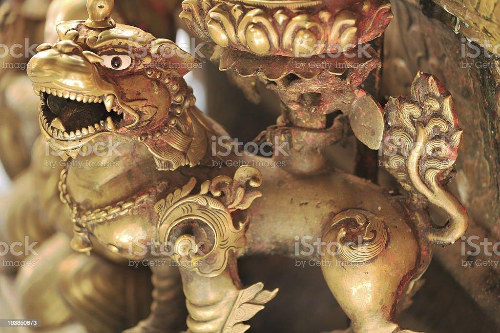 Fierce bronze lion in the Hiranya Varna Mahavihar-Golden Temple-Patan. royalty-free stock photo