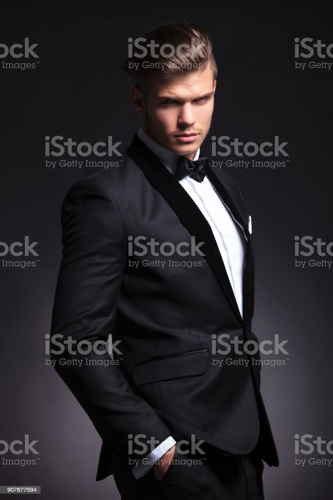 fierce business man looks at you stock photo