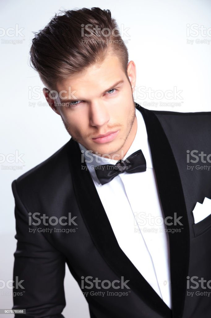 fierce fashion business man looking at you stock photo