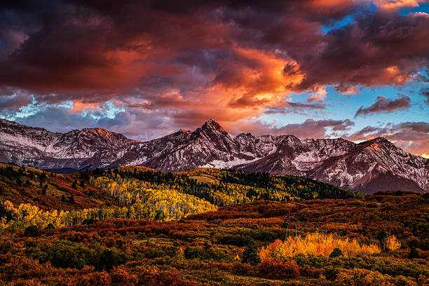 fiery autumn sunset - mountain range stock photos and pictures