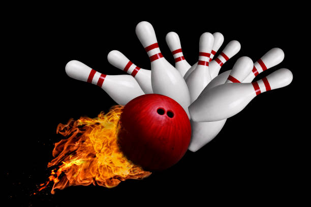 Fiery Ball Hitting Pins in Bowling Strike Isolated on Black Background stock photo