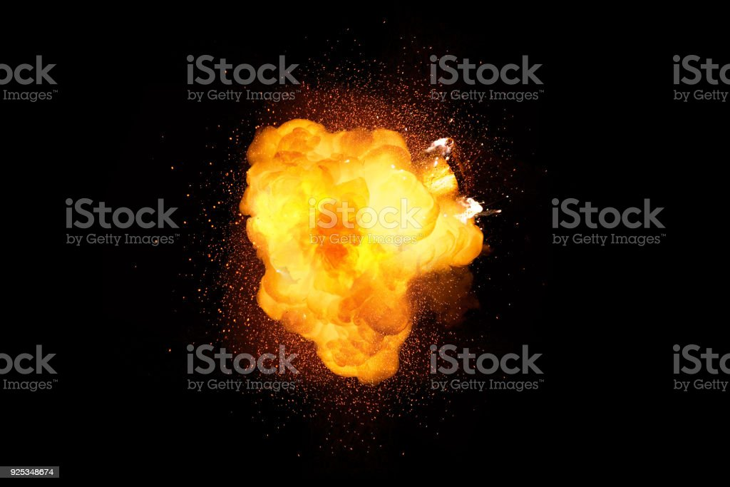 Fiery bomb explosion isolated on black background stock photo