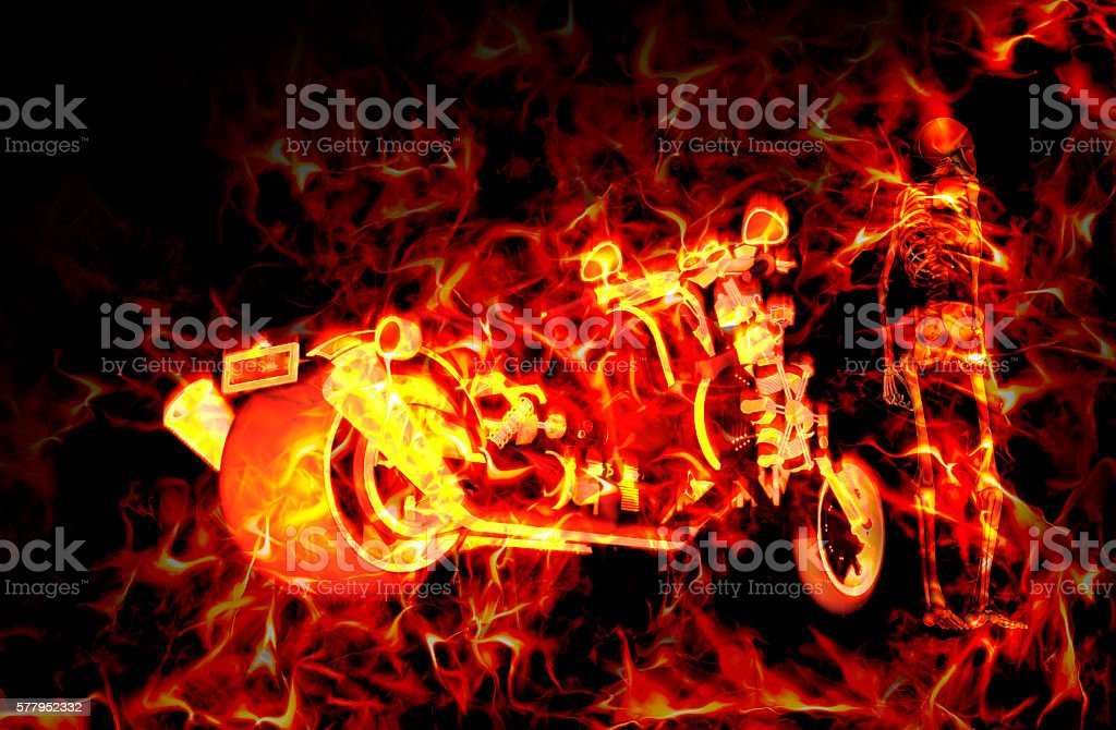 Fiery burning motorbike and skeleton with flames around them stock photo