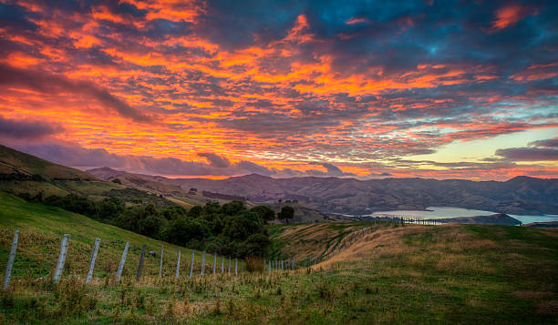 Fiery Cloud Morning Sunrise At Barrys Bays stock photo