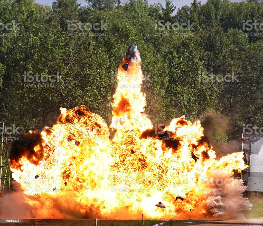 Fiery explosion in forested area stock photo