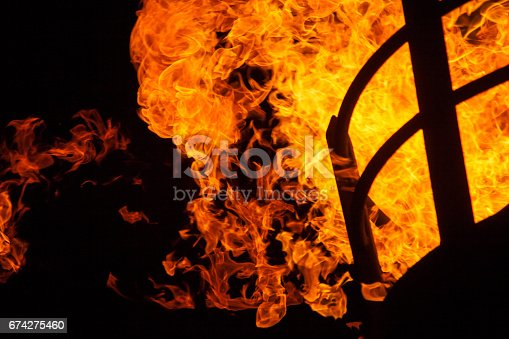 istock Fiery inferno against black sky. 674275460