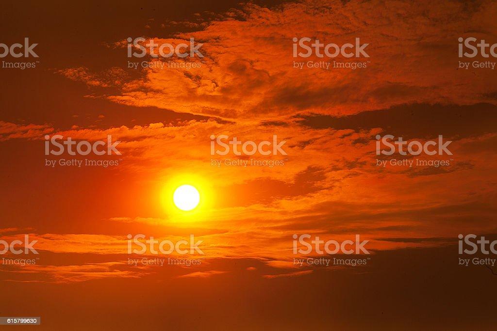 Fiery orange sunset stock photo