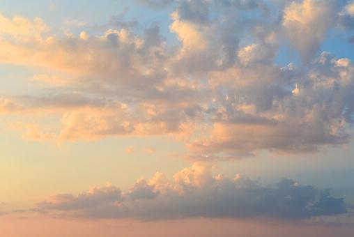 Romantic sunset sky. Beautiful fiery cumulus clouds before twilight