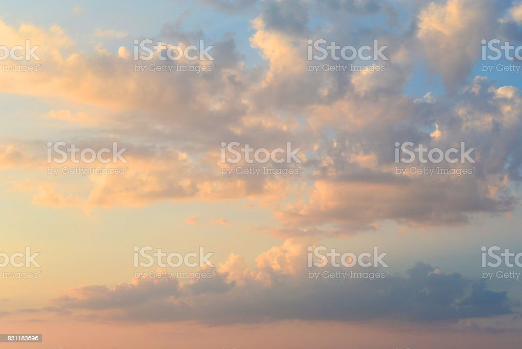 Fiery orange sunset sky. Beautiful clouds. stock photo