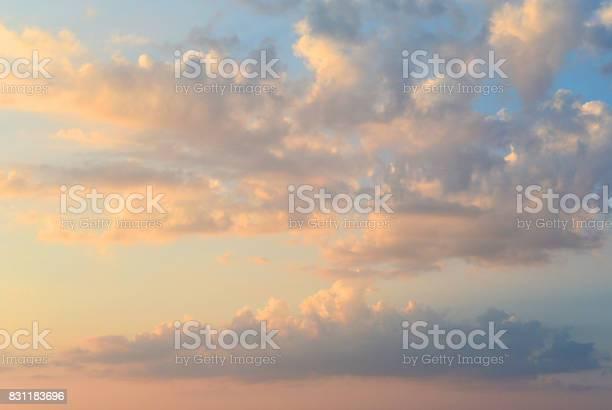 Photo of Fiery orange sunset sky. Beautiful clouds.