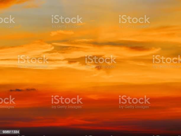 Photo of Fiery orange sunset sky. Beautiful sky background.