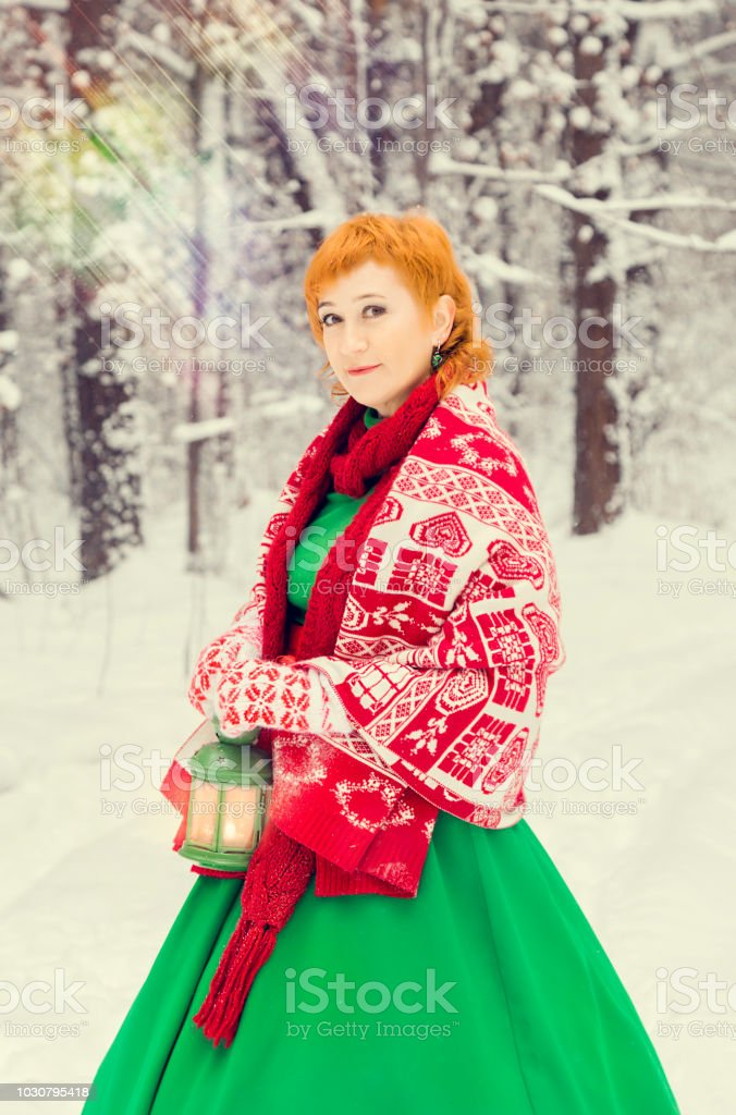 Fiery Redhaired Woman In A Ball Green Dress With A Red