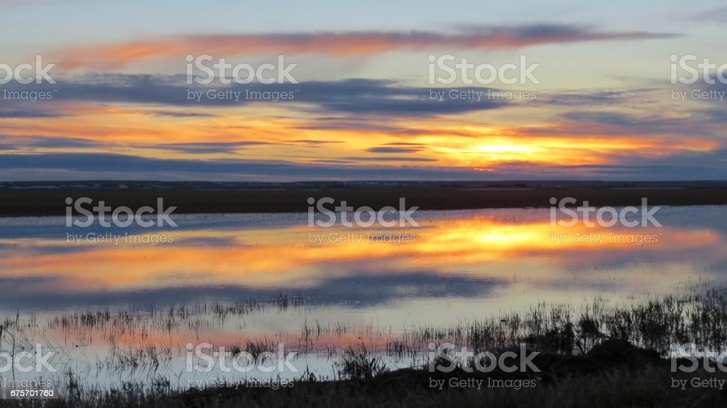 Fiery reflecting prairie sunset royalty-free stock photo