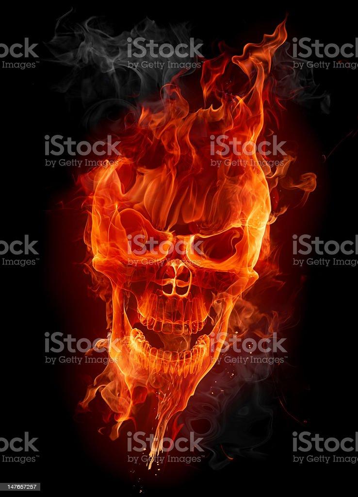 A fiery skull on a black background stock photo