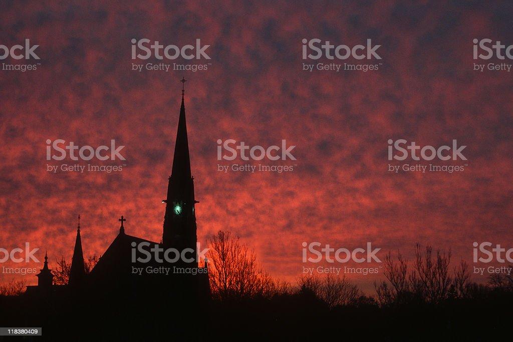 Fiery Sky and Church Steeple stock photo