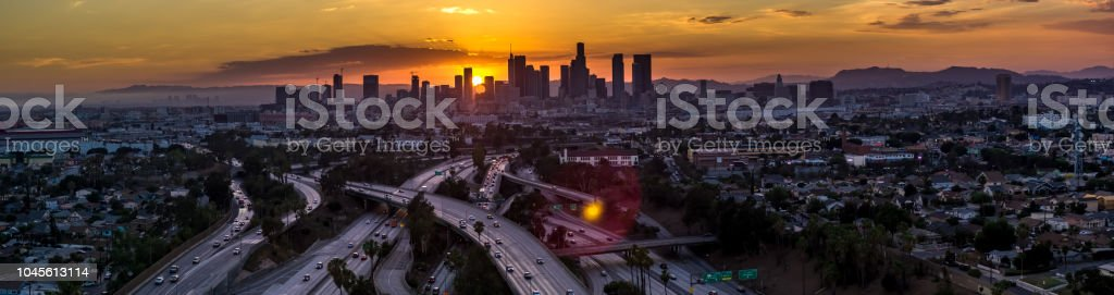 Fiery Sunset Behind the Los Angeles Skyline - Aerial Panorama stock photo