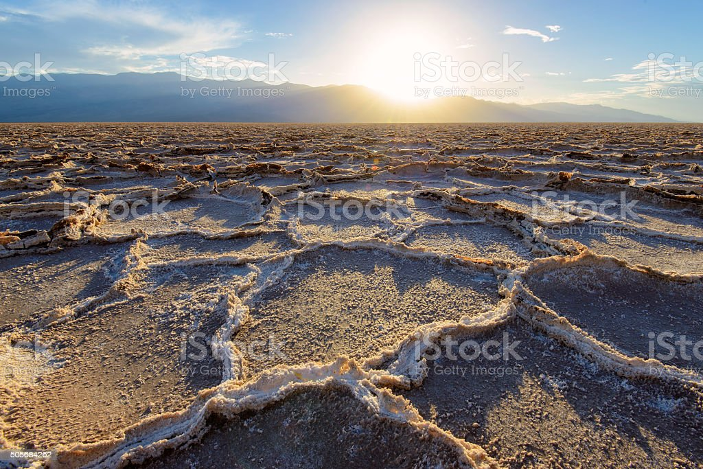 Fiery sunset over Badwater in Death Valley National Park. stock photo