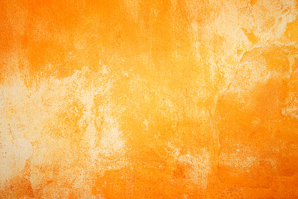 Fiery wall texture Painted wall texture/background in fiery colors. brush stroke stock pictures, royalty-free photos & images