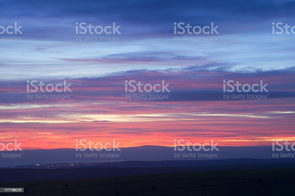 Fiery Winter sunset over town at night royalty-free stock photo