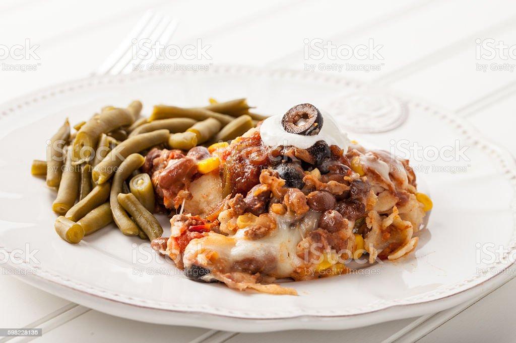 Fiesta Bake Mexican Lasagna on white foto royalty-free