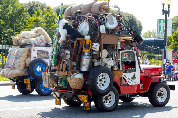Fiesta DC Washington DC, USA - September 21, 2019: The Fiesta DC, Willys jeeps, heavy loaded, going down constitution avenue, during the parade willys stock pictures, royalty-free photos & images