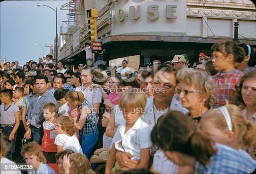 San Antonio, Texas, USA, 1960. Fiesta Parade in San Antonio. The citizens of San Antonio and the surrounding area watch the parade from the roadside.