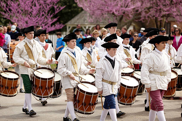 Fife and Drums Williamsburg, Va. USA - March 26, 2016: On a Spring morning the ensemble Fife and Drums at  Colonial Williamsburg in Virginia march along the towns street playing their musical instruments. colonial style stock pictures, royalty-free photos & images