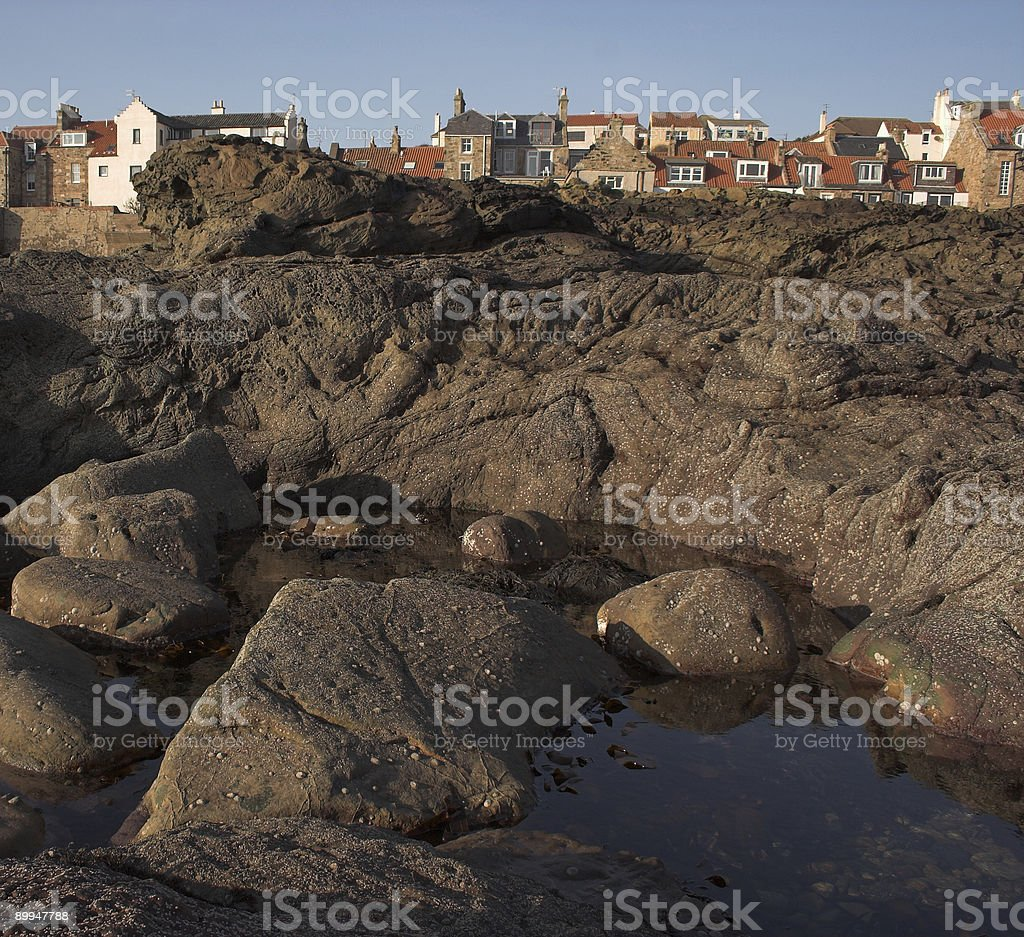 Fife coastline with rocky beach in foreground stock photo