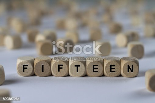istock fifteen - cube with letters, sign with wooden cubes 800587234