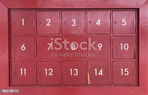 istock Fifteen red wooden mailbox 853138774
