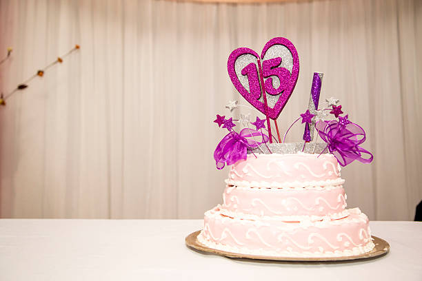 Fifteen years birthday party cake, pink and white. 15 years birthday party cake, pink and white. Candles and heart. Celebration. 14 15 years stock pictures, royalty-free photos & images
