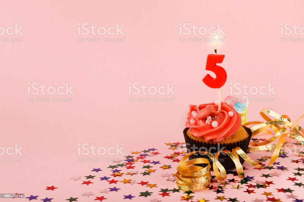 Fifth Birthday Cupcake With Candle And Sprinkles Stock Photo More