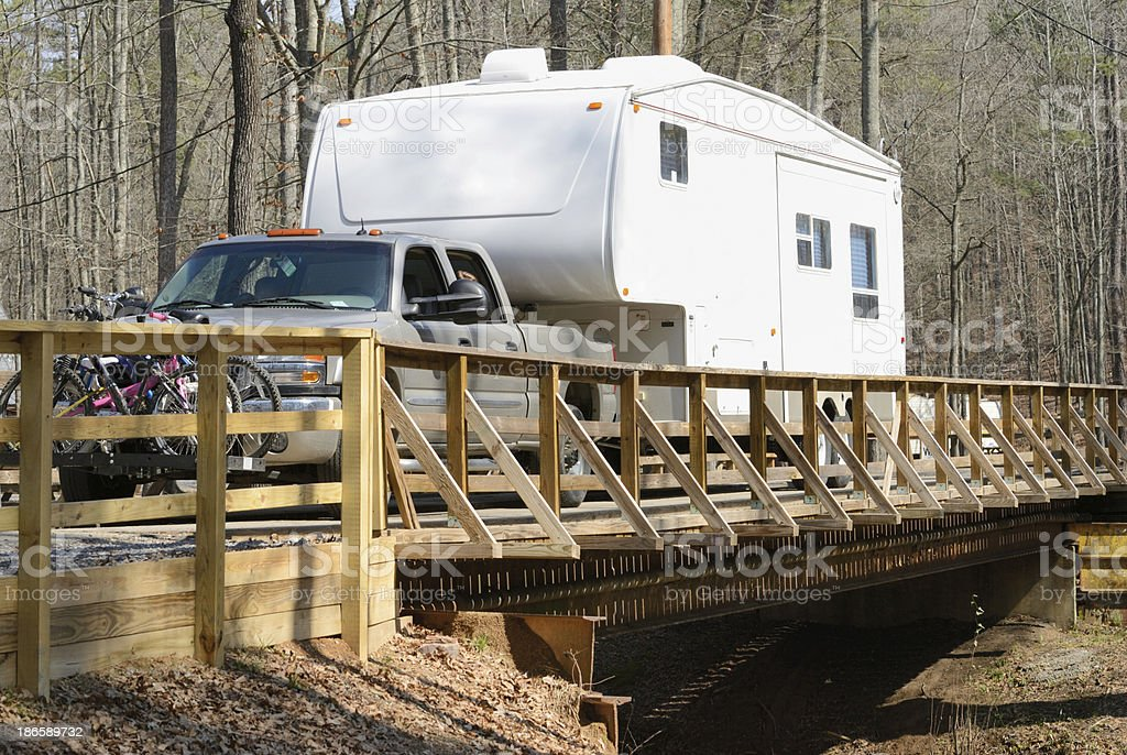 Fifth wheel and pickup truck crossing small bridge royalty-free stock photo