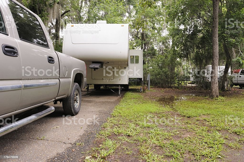 Fifth wheel and pickup truck in campsite royalty-free stock photo