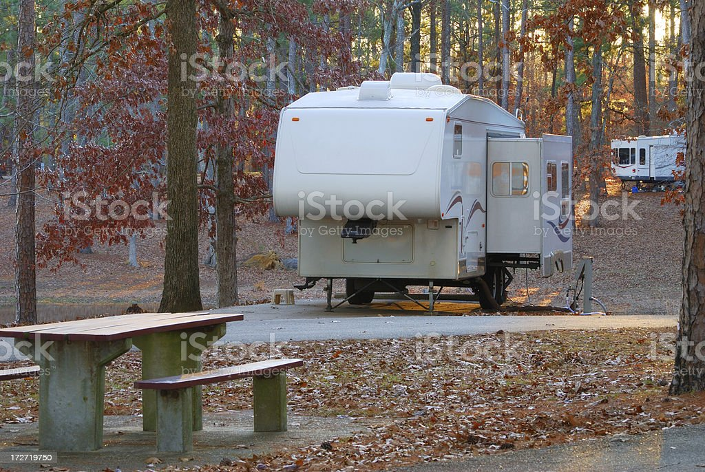 Fifth wheel campers in campground stock photo