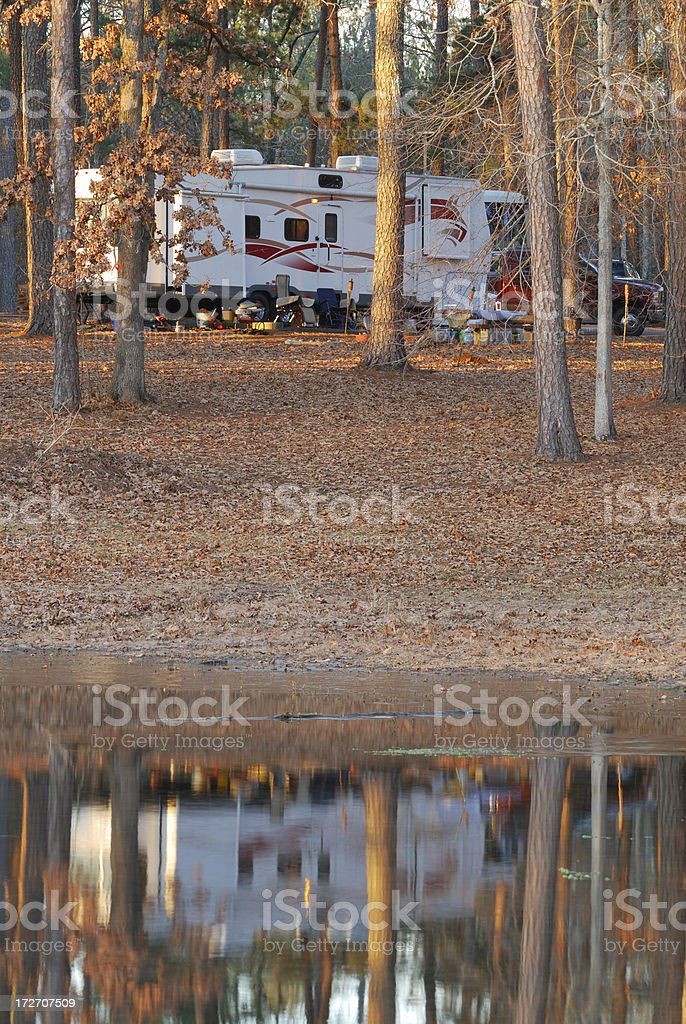 Fifth wheel reflecting in lake stock photo
