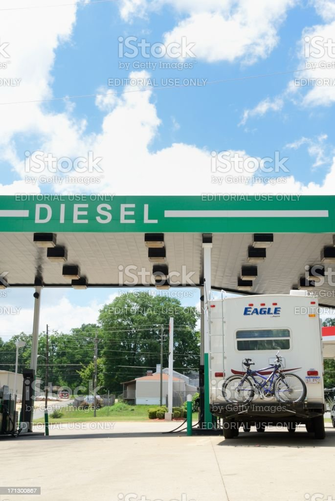 Fifth wheel rv at diesel station refueling stock photo