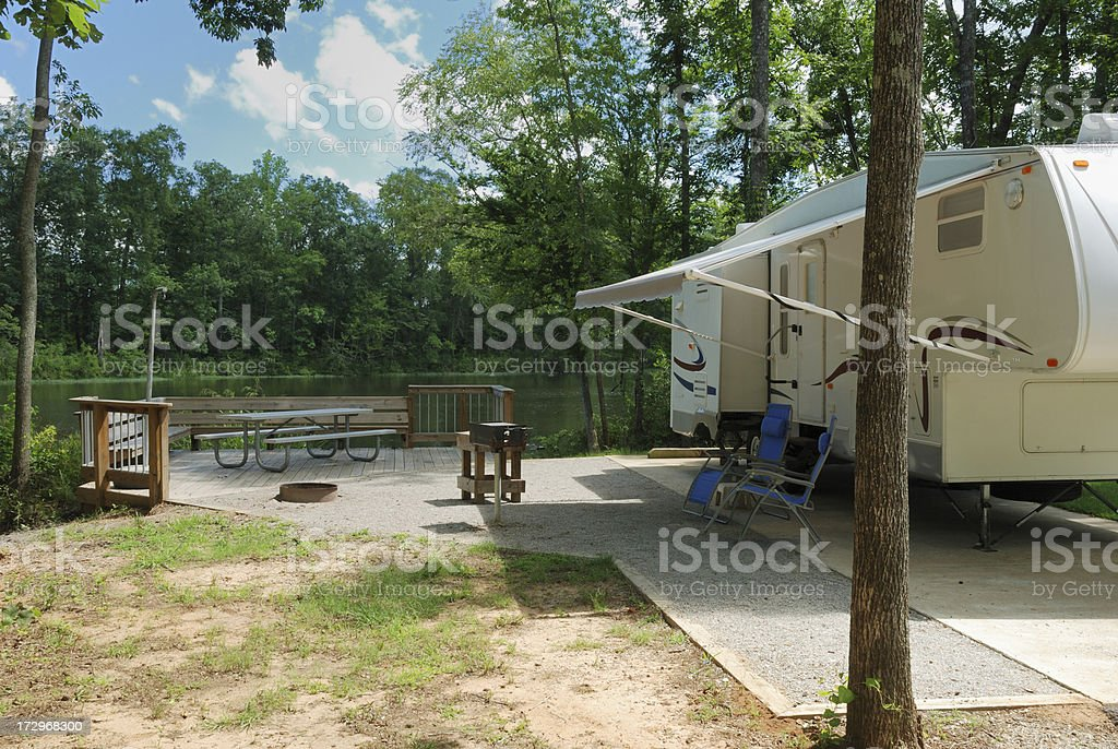 Fifth wheel rv trailer at campsite stock photo