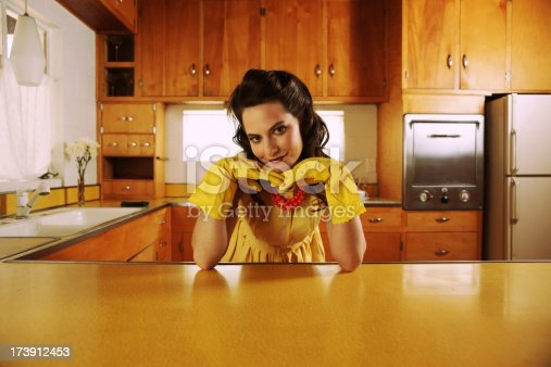 istock Fifties Housewife in Kitchen 173912453