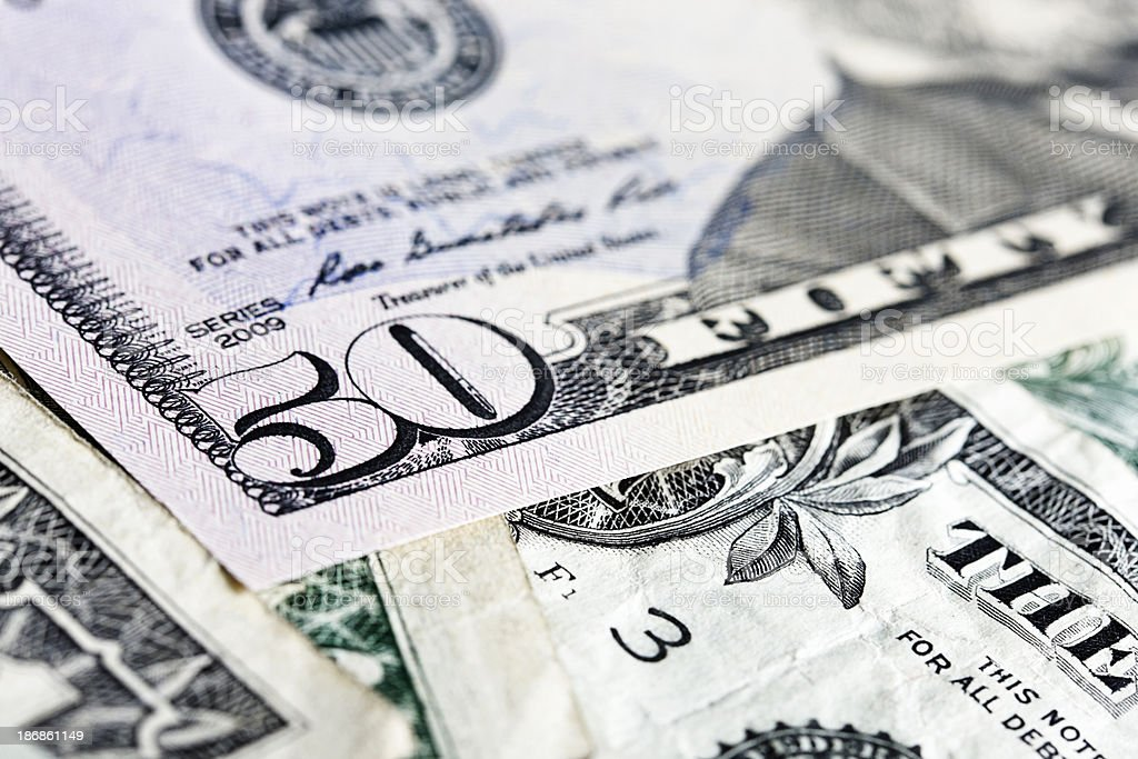 Fifty American dollars in close up with more underneath stock photo